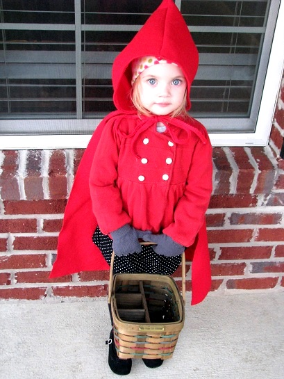 little girl wearing little red riding hood costume