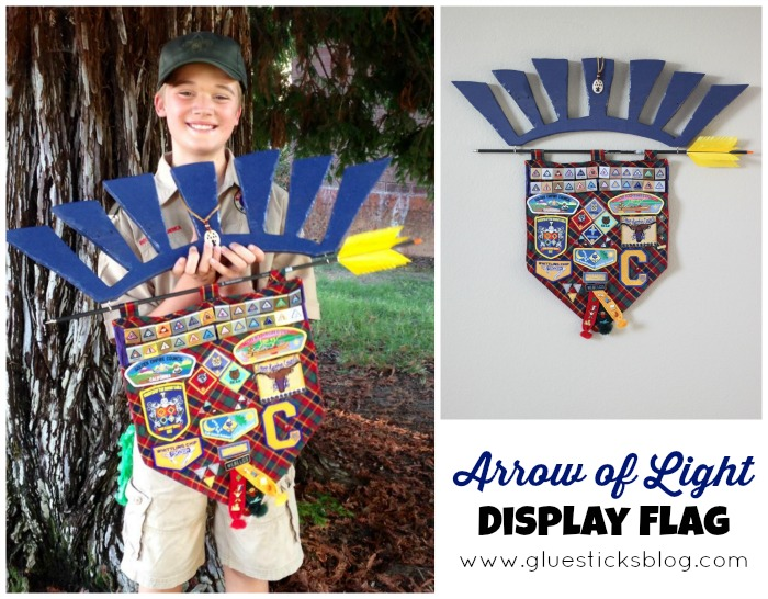 boy holding arrow of light display