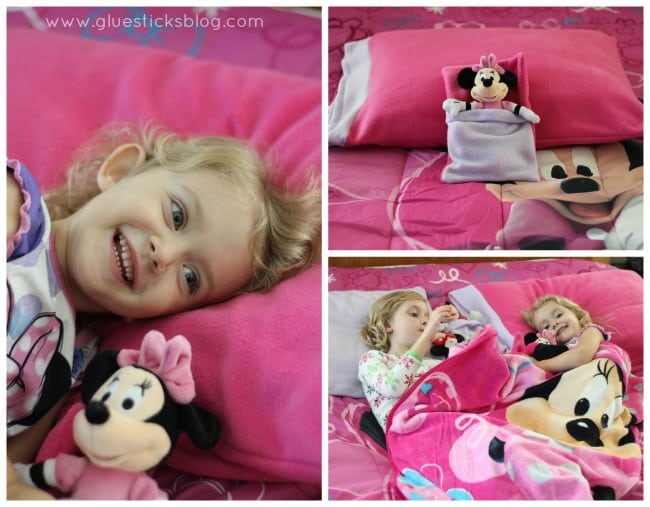 little girls laying on Minnie Mouse bedding