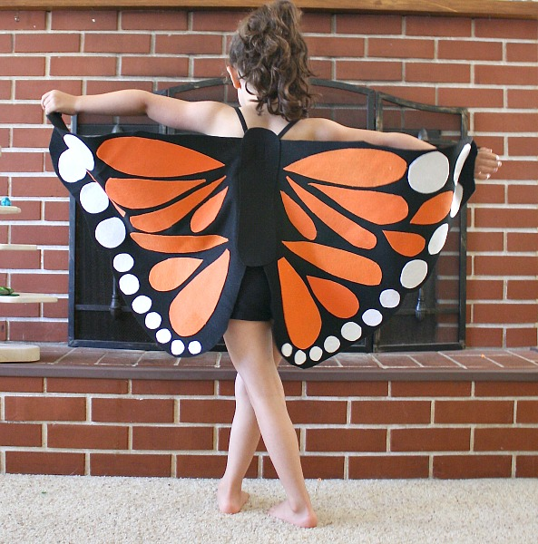 little girl wearing butterfly costume