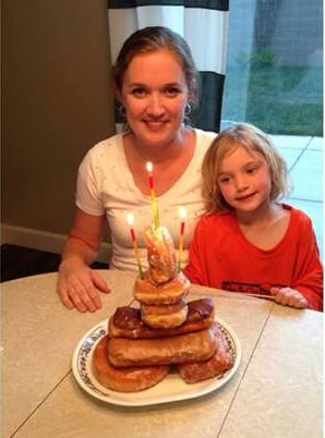 mom and little girl with donut cake