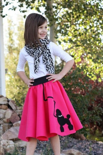 little girl in 50's poodle skirt costume