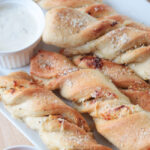 platter of garlic twists and dipping sauces