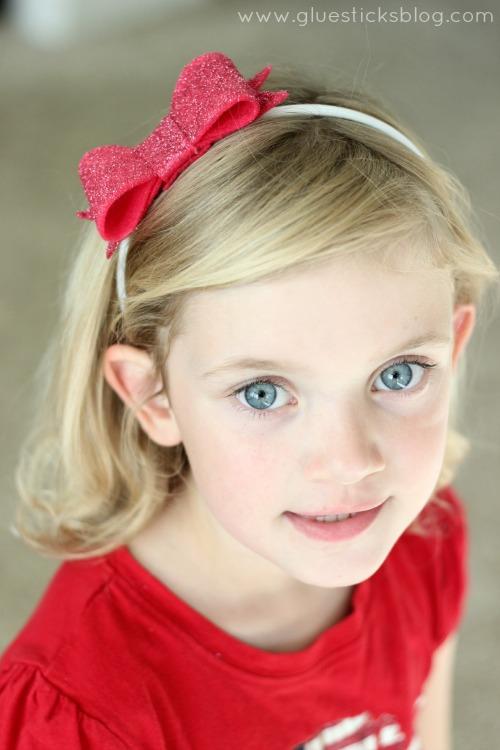 little girl wearing felt bow headband