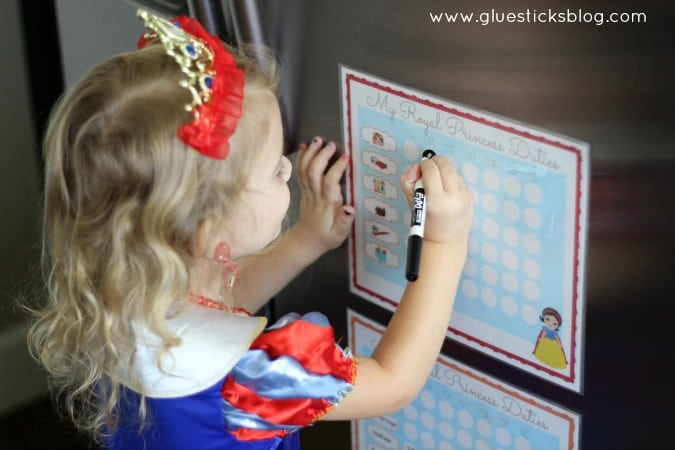 little girl marking off chores on her chart