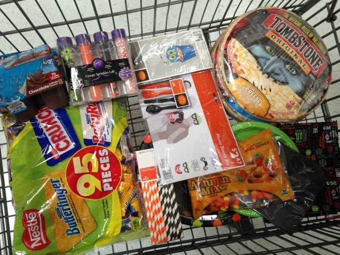 cart full of halloween party supplies