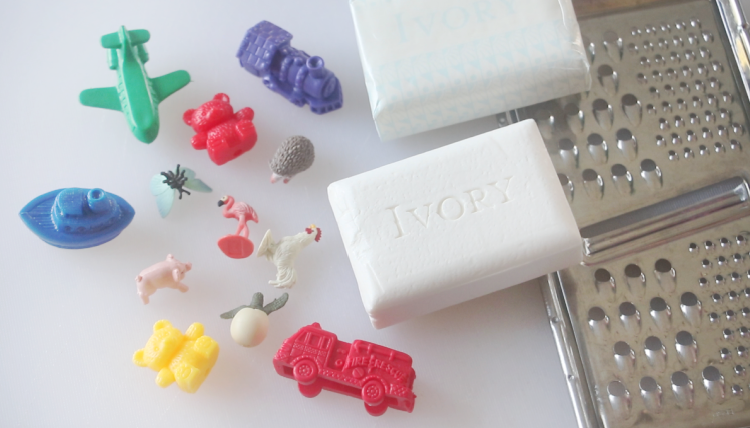 cheese grater, bars of ivory soap and small toys
