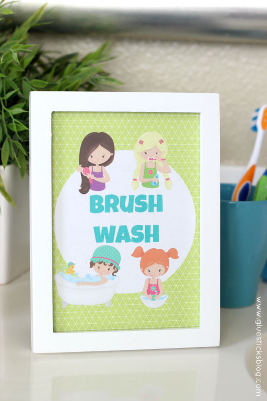 kids bathroom printable in white frame on counter