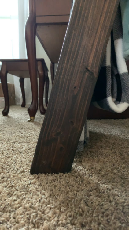 bottom view of blanket ladder, leaning against carpet