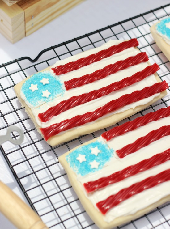 Take your 4th of July BBQ up a notch with a County Fair inspired backyard get together! Complete with all American hot dogs, Twizzlers flag cookies, Red, White, & Blue fruit cups, and Americana decor.