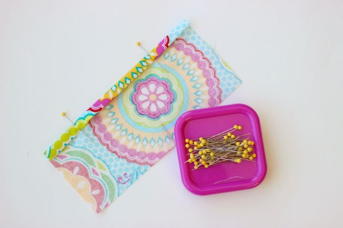 A 2 sided tissue holder pouch is perfect for cold and flu season. One side can hold a pack of tissues, the other side can hold a mini bottle of sanitizer and a lip gloss!