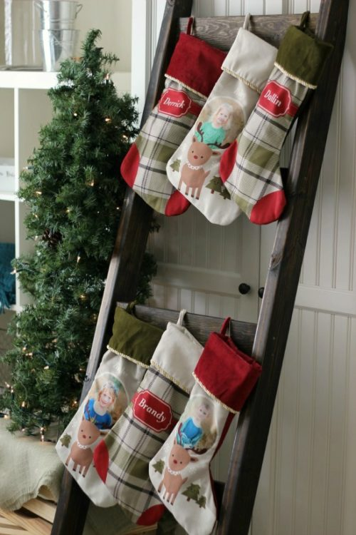 blanket ladder with 6 stockings strung from it to use as a stocking hanger