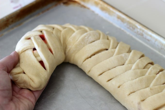 forming loaf into candy cane shape on baking pan