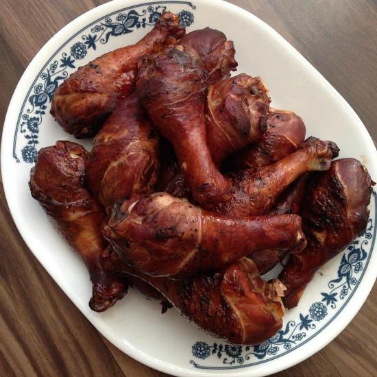 grilled chicken legs on a platter