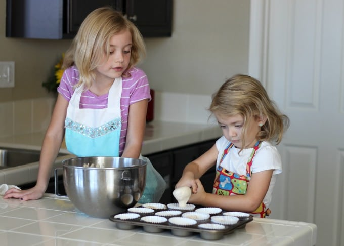 girls baking cupcakes