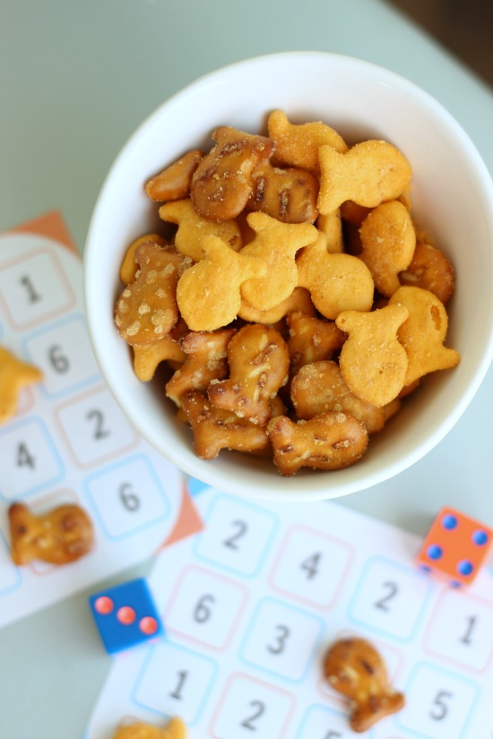 bowl of goldfish crackers next to game cards