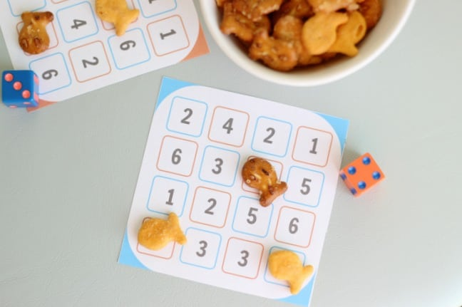 number dash game cards on table with dice