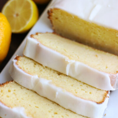 slices of easy lemon loaf cake on platter