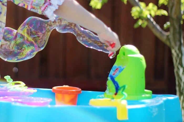 Make your own bubbles this summer with this 3 ingredient homemade bubble recipe. Simply combine water, dish soap, and glycerin! Fill up a large jug with homemade bubbles to have plenty on hand when spill happen, because they always do!