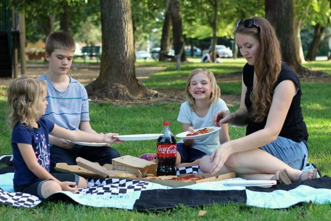 family having a picnic on bandanna picnic blanket