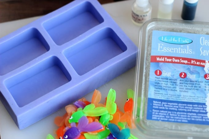 fish soap supplies: soap mold, plastic fish, glycerin soap blocks, coloring and scents