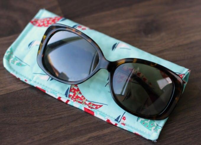 sunglasses resting on sunglasses case