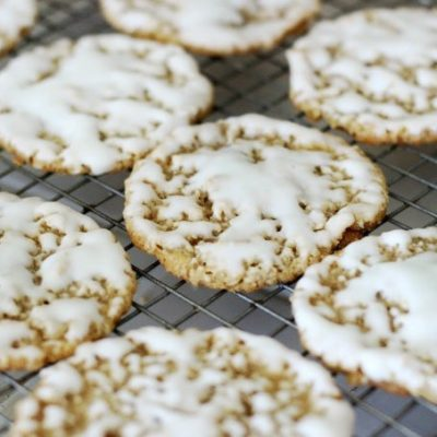iced oatmeal cookies on cooling rack