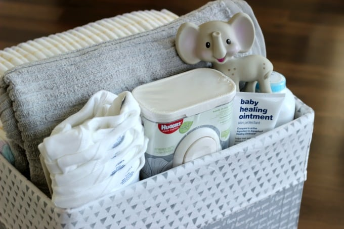 Turn a diaper box into a storage tote for a nursery. The perfect way to store everything to make diaper changing time a breeze!