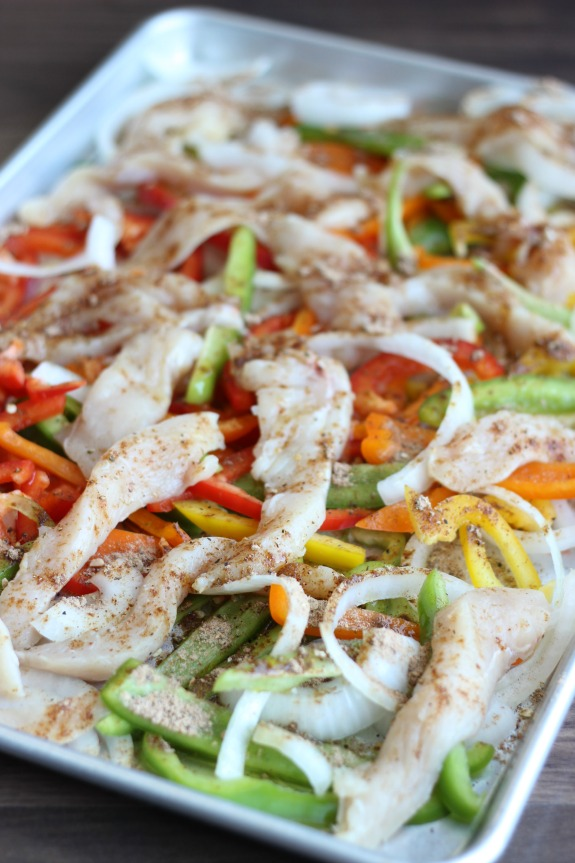 uncooked chicken and vegetables for fajitas