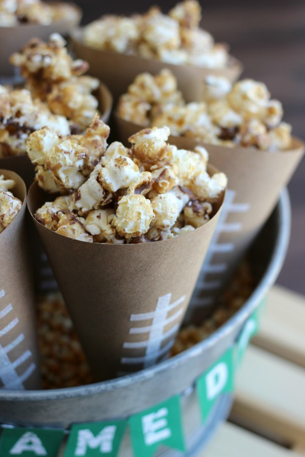Always a crowd pleaser, this chocolate caramel popcorn is easy to make and very addicting. Make a batch for your next party. Also a simple tutorial for popcorn cones (holders).