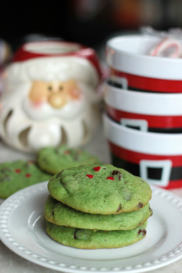 Peppermint extract, chocolate chips, heart sprinkles, and green cookie dough combine to create...GRINCH cookies! These are sure to be a hit at any holiday gathering this year!