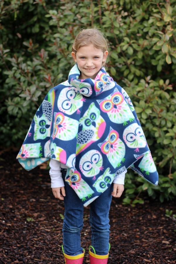 girl wearing cowl neck fleece poncho