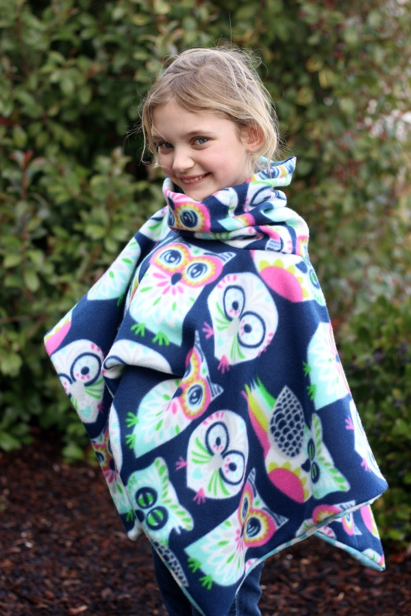 2 yards of fleece and 30 minutes of time is all you need to make this darling cowl neck fleece poncho that is perfect for snuggling up in on a cool day! It even has a hood!