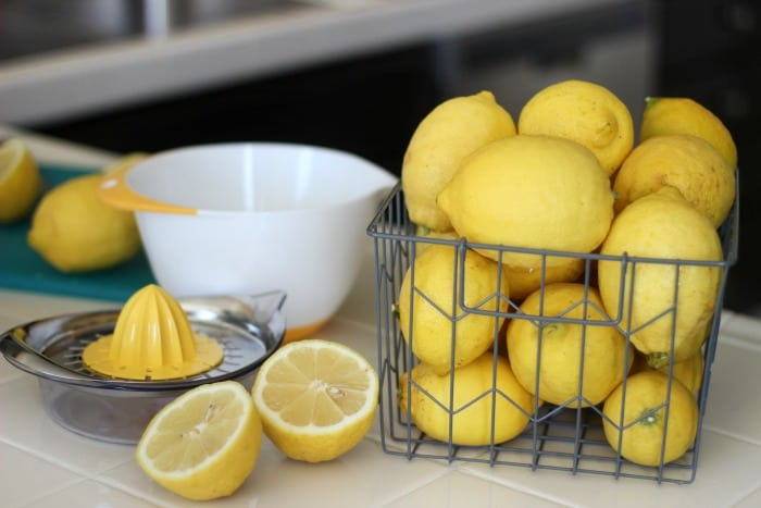 basket of lemons and lemon juicer