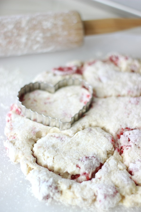 heart cookie cutter on top of rolled out scone dough