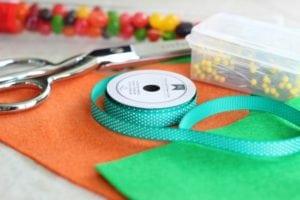orange and green felt and green ribbon