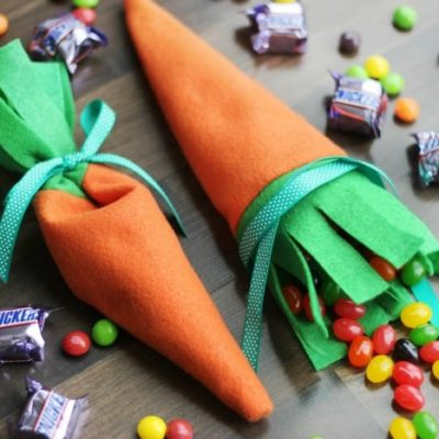 two carrot candy pouches filled with jelly beans