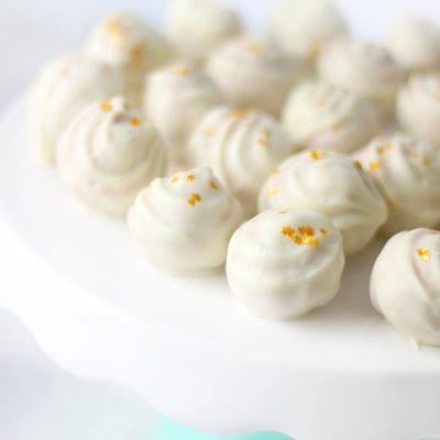 white chocolate truffles on cake stand