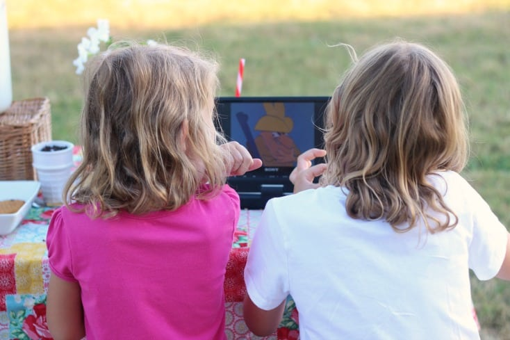 kids watching an out door movie