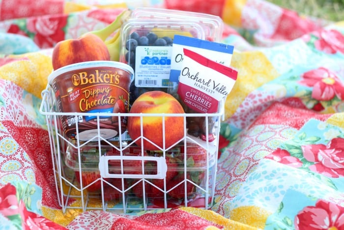 A fresh fruit and chocolate gift basket perfect for summer giving! Not your typical fruit basket either. Strawberries, raspberries, blueberries, bananas & peaches. Tucked inside a basket with dipping chocolate! The perfect gift for a teacher!