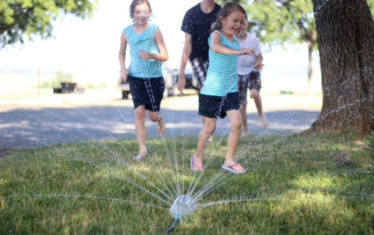 What can you make with a 2-liter soda bottle and some tape? Why, the best homemade soda bottle sprinkler around, that's what!