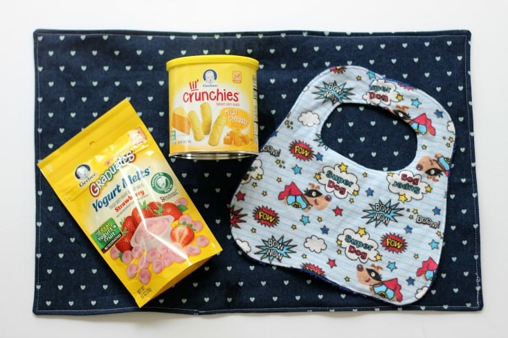 Make a bib out of a washcloth and a placemat in 30 minutes to catch spills from the messy little ones in your home! Two easy sewing projects for beginners!