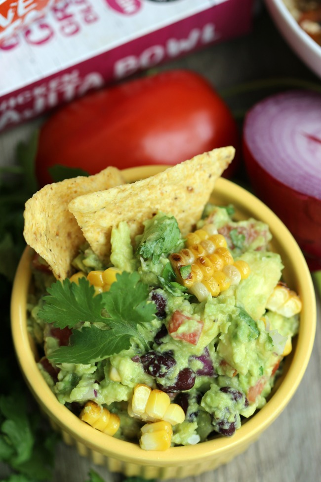 Bold, colorful and flavorful. This black bean and corn guacamole recipe hits the spot any day of the week. Perfect to serve with chips, or to add to a southwest rice bowl.