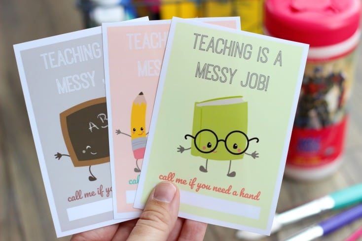 A cute and practical back to school gift idea for the classroom. Let your child's teacher know that they can count on you for help during the school year by attaching this darling printable to a container of hand wipes or a bottle of hand sanitizer!