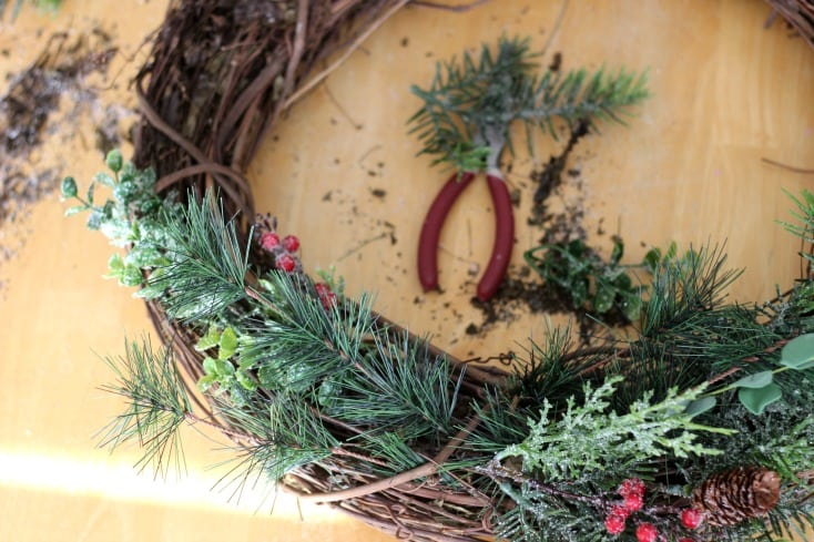 Make a gorgeous winter berry wreath for your front door with a few supplies from your local craft store. An easy to follow wreath tutorial and inexpensive way to add a touch of color and to your home this holiday season!