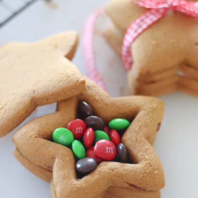 open gingerbread cookie box filled with candies