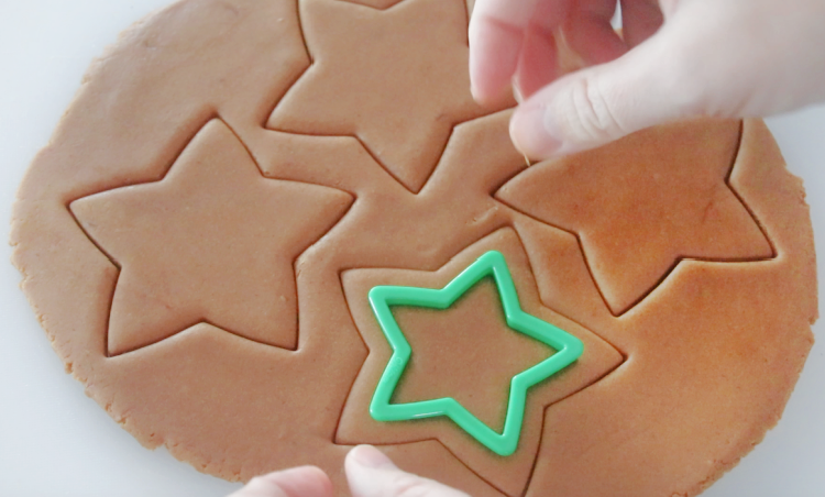 star cookie cutter cutting out gingerbread cookies