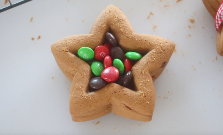 star gingerbread cookies with center cut out and filled with M&M candies
