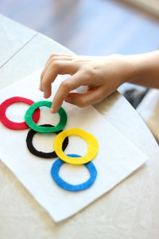 Here's fun little Olympics craft to make with the kiddos before the opening ceremonies. Do you know what the colored rings represent? When the symbol was created in 1913, the 6 colors (including the white background) represented the colors of every nation's flag!