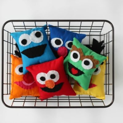 sesame street softies in basket